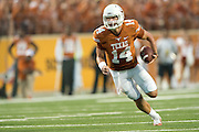 AUSTIN, TX - AUGUST 31: David Ash #14 of the Texas Longhorns scrambles against the New Mexico State Aggies on August 31, 2013 at Darrell K Royal-Texas Memorial Stadium in Austin, Texas.  (Photo by Cooper Neill/Getty Images) *** Local Caption *** David Ash