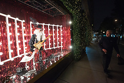 © Licensed to London News Pictures. 18/10/2018. London, UK. A man walks past a  Selfridges department store Christmas festive window display with a 'Selfridges Rocks Santa' theme. It is the first department store in the world to unveil Christmas windows. Photo credit: Ray Tang/LNP