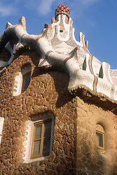 Parc Guell; Barcelona; designed by Gaudi; with ceramic tiled roof on entrance lodge,