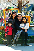 The Magniere-Wang Family is photographed on Marion Street in Oak Park on Saturday, December 5th. © 2015 Brian J. Morowczynski-ViaPhotos