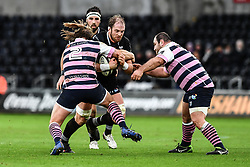 Ospreys' Alun Wyn Jones is tackled by Cardiff Blues' Kristian Dacey<br /> <br /> Photographer Craig Thomas/Replay Images<br /> <br /> Guinness PRO14 Round 13 - Ospreys v Cardiff Blues - Saturday 6th January 2018 - Liberty Stadium - Swansea<br /> <br /> World Copyright © Replay Images . All rights reserved. info@replayimages.co.uk - http://replayimages.co.uk