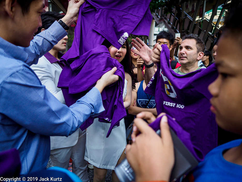 24 JANUARY 2019 - BANGKOK, THAILAND:  Taco Bell spokespeople hand out Taco Bell tee shirts at the grand opening of the first Taco Bell in Thailand. The restaurant has a 215 square meter space in the Mercury Ville, a mixed use retail/office building in central Bangkok. Taco Bell is owned by Yum Brands, which also owns KFC, Pizza Hut, and WingStreet. Taco Bell in Thailand joins KFC, which has more than 500 restaurants in Thailand and Pizza Hut, which recently started expanding in Thailand.    PHOTO BY JACK KURTZ