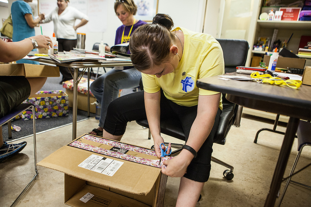 Lindsay Fertig '14 of the Lutheran Deaconess Association help decorate collection boxes for Dayspring Women's Center in Valpariaso, IN. (Jeff Lange)