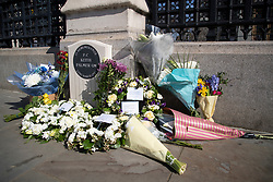 © Licensed to London News Pictures. 22/03/2021. London, UK. Floral tributes have been left at the the PC Keith Palmer memorial outside the Houses of Parliament. Today marks four years since the Westminster Bridge terror attack and a commemorative plaque is expected to be installed on Westminster Bridge when Coronavirus restrictions are lifted . Photo credit: George Cracknell Wright/LNP