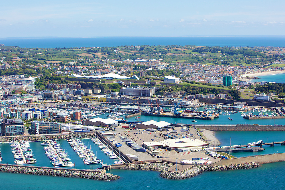 Aerial View of the boats moored up at Jersey harbour, Castle Quay, Fort Regent and St Helier in Jersey, Channel Islands