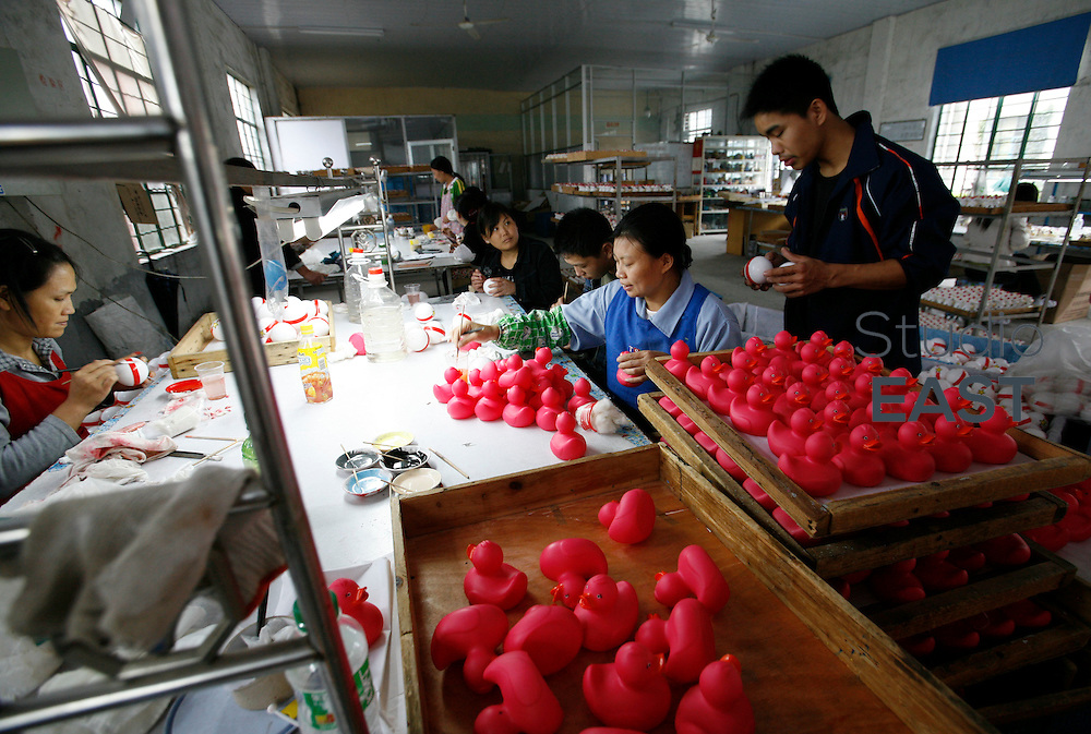 FENGXIANG, CHINA - October 30: Workers work on toy plastic figures, in a factory on October 30, 2008 in Fengxiang, near Shanghai, China. Although Chinese authorities predict that 2009 will be a tough year, they are ready to do all that takes to keep China's growth ''around 8%''. Beijing government announced a 450 billion Euros investment plan until 2010 to boost Chinese economy. ''We could take new measures (...) to prevent any economical downturn'' said Premier Wen Jiabao in Davos 2009 economy forum. (Photo by Lucas Schifres/Getty Images)