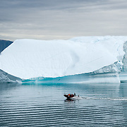 A small boat from a cruise ship vising the small fishing village known as Uummannaq, Davis Straights, Greenland