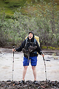 Liana Welty celebrates with great relief a successful (but very cold) river crossing on a backpacking trip in the Skolai Pass area of Wrangell-St. Elias National Park, Alaska.