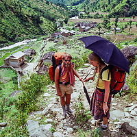 Trekkers on a hot steep trail during a monsoon trek to the Khumbu region of Nepal, 1980