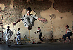 KABUL,AFGHANISTAN - SEPT. 12:  An Afghan teaches Tae Kwon Do in the bombed out former Presidential Palace in Kabul, Afghanistan September 12,2002.   (Photo by Ami Vitale/Getty Images)