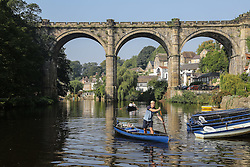 © Licensed to London News Pictures. 15/09/2016. Ripon, UK. © Licensed to London News Pictures.  A man moves a rowing boat in the scorching temperatures and sunshine on the River Nidd in Knaresborough, North Yorkshire. The start of this month has seen the hottest September temperatures since 1911.  Photo credit : Ian Hinchliffe/LNP