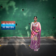 A beautifully dressed Indian woman going to a wedding in Nainital.
