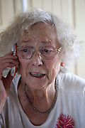 Polish great grandmother age 88 conversing on her cell phone. Zawady Central Poland