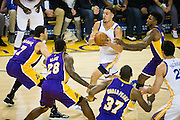 Golden State Warriors guard Klay Thompson (11) takes the ball to the basket against the Los Angeles Lakers at Oracle Arena in Oakland, Calif., on November 23, 2016. (Stan Olszewski/Special to S.F. Examiner)