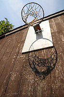 Vintage Basketball hoop on side of building