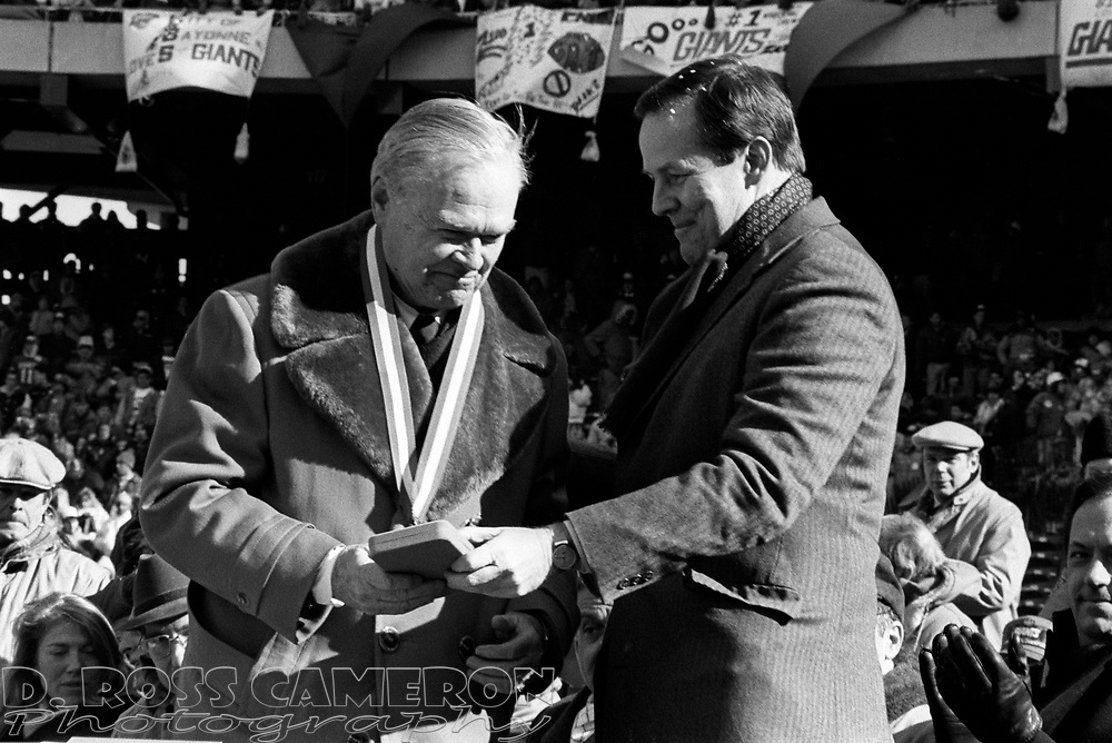 New York Giants principal owner Wellington Mara, left, hands a commemorative medal to New Jersey Gov. Thomas H. Kean at a victory celebration for the football team, Tuesday, Jan. 27, 1987 at Giants Stadium in East Rutherford, N.J. The Giants defeated the Denver Broncos Sunday in Super Bowl XXI, 39-20. (D. Ross Cameron/North Jersey Advance)