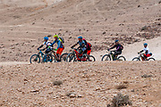 Group of cyclists exploring the Negev Desert, Israel at Wadi Tzeelim [Tzeelim Stream] Near Arad, Israel