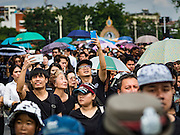14 OCTOBER 2016 - BANGKOK, THAILAND: People use their smart phones to take pictures of the crowd mourners on Rajadamnoen Avenue for Bhumibol Adulyadej, the King of Thailand, who died Oct. 13, 2016. He was 88. His death comes after a period of failing health. With the king's death, the world's longest-reigning monarch is Queen Elizabeth II, who ascended to the British throne in 1952. Bhumibol Adulyadej, was born in Cambridge, MA, on 5 December 1927. He was the ninth monarch of Thailand from the Chakri Dynasty and is known as Rama IX. He became King on June 9, 1946 and served as King of Thailand for 70 years, 126 days. He was, at the time of his death, the world's longest-serving head of state and the longest-reigning monarch in Thai history.     PHOTO BY JACK KURTZ