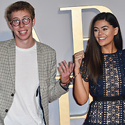 Young and kink handcuffs to each other Callum Airey (L) and Emily Canham attend A Star Is Born UK Premiere at Vue Cinemas, Leicester Square, London, UK 27 September 2018.