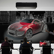 A car design team using a Sony projector as part of a commercial location photoshoot.