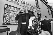 1993 St Patrick's Day Parade Sneem, County Kerry Ireland.  'Big Bertha', having reached the age of 48 years and appearing in the Guinness Book of Records as the world's oldest cow is grand marshall at the annual St. patrick's Day Parade in Sneem Country Kerry. In this photograph Big Bertha and Jerome enjoys a pint outside Murphy's Pub in Sneem after the parade. She died a few montha later on New Year's Eve 1993.<br /> Photo: Don MacMonagle <br /> e: info@macmonagle.com