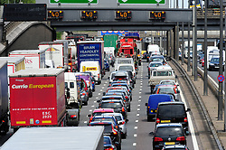 © Licensed to London News Pictures. 21/07/2017<br /> M25 Anti Clock-wise traffic CHAOS towards the Dartford crossing from Kent into Essex. Traffic is at a near standstill as the summer holiday getaway madness begins as the schools break up for the summer.<br /> Photo credit: Grant Falvey/LNP