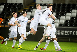 SWANSEA, WALES - Tuesday, January 10, 2017: Swansea City's Oliver McBurnie celebrates the first equalising goal against Wolverhampton Wanderers with team-mates during the Football League Trophy 3rd Round match at the Liberty Stadium. (Pic by Gwenno Davies/Propaganda)