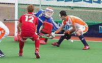 MELBOURNE -  Keeper Pirmin Blaak stopt de bal  tijdens de hockeywedstrijd tussen de mannen van Nederland en Belgie (5-4) bij de Champions Trophy hockey in Melbourne. rechts Marcel Balkestein. ANP KOEN SUYK