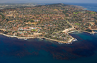 Aerial view of Palos Verdes, looking east toward Huntington Beach, with a productive kelp forest in the foreground along the coast.