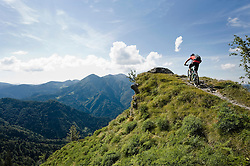 mountain biker on the way uphill, Slatnik, Istria, Slovenia