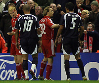 Photo: Paul Thomas.<br /> Liverpool v Bordeaux. UEFA Champions League, Group C. 31/10/2006.<br /> <br /> John Arne Riise (L) of Liverpool looks at the blood on his hands made by Menegazzo Fernando (5), who later gets sent off.