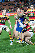 Buxton Popoalii gets tackeled by Tawera Kerr Barlow during their Round 9 ITM cup Rugby match, Waikato v Otago, at Waikato Stadium, Hamilton, New Zealand, Sunday 13 August  2011. Photo: Dion Mellow/photosport.co.nz