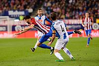 Atletico de Madrid's player Yannick Carrasco and RCD Espanyol player Victor Sanchez during match of La Liga between Atletico de Madrid and RCD Espanyol at Vicente Calderon Stadium in Madrid, Spain. December 03, 2016. (ALTERPHOTOS/BorjaB.Hojas)