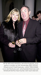 MR & MRS NICK MASON, he is the musician, at a party in London on 6th November 2001.	OTX 23