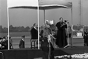 Pope John-Paul II visits Ireland..1979..29.09.1979..09.29.1979..29th September 1979..Today marked the historic arrival of Pope John-Paul II to Ireland. He is here on a three day visit to the country with a packed itinerary. He will celebrate mass today at a specially built altar in the Phoenix Park in Dublin. From Dublin he will travel to Drogheda by cavalcade. On the 30th he will host a youth rally in Galway and on the 1st Oct he will host a mass in Limerick prior to his departure from Shannon Airport to the U.S..Image of Cardinal Tomás Ó Fiach as he welcomes the Pope to Ireland on behalf of Catholic Church in ireland