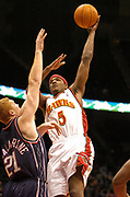 December 11, 2004, Atlanta, Georgia, USA;  Josh Smith of the Atlanta Hawks shoots over the defense of Brian Scalabrine of the New Jersey Nets as the Hawks lose to the Nets 95-90.