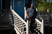 Ed Atkins poses for a portrait outside his bait shop on Lady Island, S.C., Tuesday, October 19, 2021. Atkins, who is part of the Gullah Geechee nation in South Carolina, says the warming seas have impacted his capacity to fish for bait in the South Carolina sea islands — he can catch shrimp far later into the year, and is still waiting to harvest his first oysters.<br /> <br /> (Photo by Cameron Pollack for NPR)