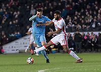 Football - 2017 / 2018 FA Cup - Fourth Round: Milton Keynes Dons vs. Coventry City<br /> <br /> Ethan Ebanks-Landell (MK Dons) sticks a leg out and brings over Maxime Biamou (Coventry City) at the Stadium MK.<br /> <br /> COLORSPORT/DANIEL BEARHAM