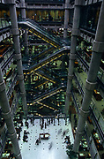 "From a high vantage point looking across the atrium of British architect Sir Richard Rogers' Lloyds building, we see the post-modern architecture of the insurance underwriters Lloyd's building, home of the insurance institution Lloyd's of London which is located at number 1, Lime Street, in the heart of the City of London. Lloyd's is a British insurance market. It serves as a meeting place where multiple financial backers or ""members"", whether individuals (traditionally known as ""Names"") or corporations, come together to pool and spread risk. Unlike most of its competitors in the reinsurance market and is neither a company nor a corporation. The Lloyds market began in Edward Lloyd's coffeehouse around 1688 and is today the world's leading insurance market providing specialist insurance services to businesses in over 200 countries and territories."
