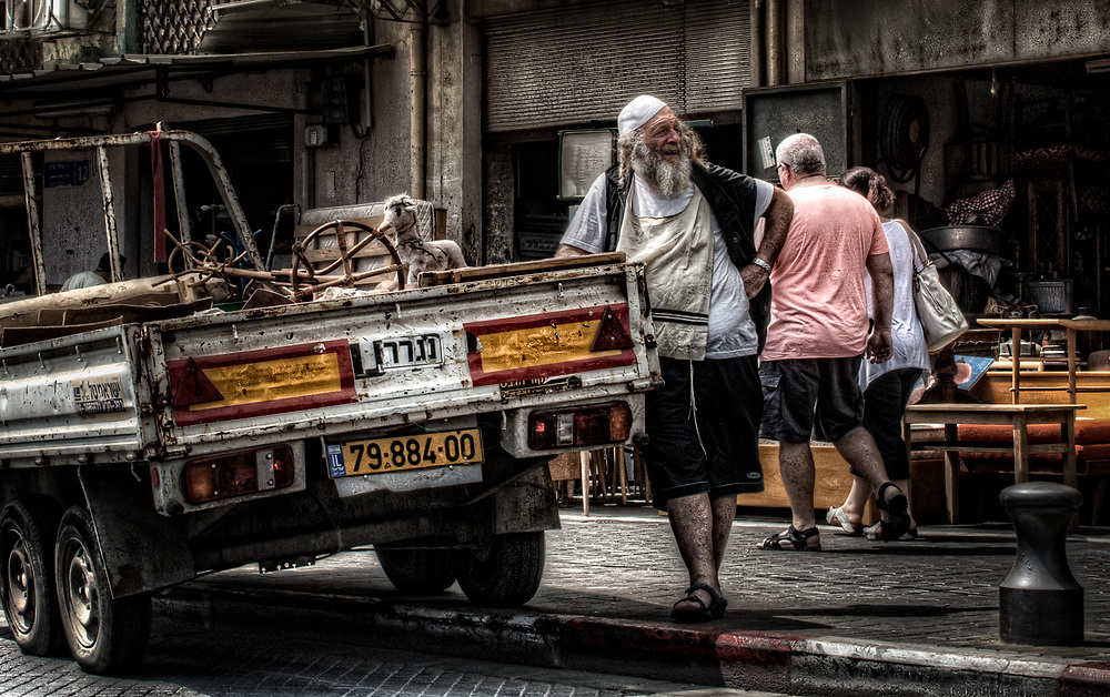 The religious driver leaning on his truck waiting for work in Yafo, Israel