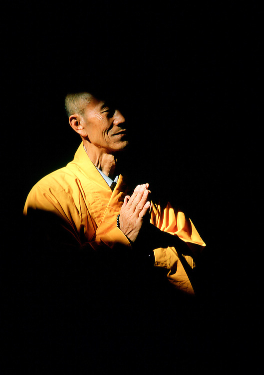 Buddhist monk praying at Huating Temple, China RESERVED USE - NOT FOR DOWNLOAD -  FOR USE CONTACT TIM GRAHAM
