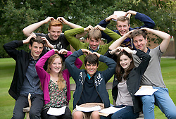 "© Licensed to London News Pictures.22/08/2013. Solihull, West Midlands, UK. Solihull School achieved outstanding GSCE Level Results this year, up on previous years, with 77% of pupils gaining A grade or A Stars. Pictured, 80 A stars, that's 10 each, back from left, Joe Lankaster (correct), Isaac Webber, Harry Sharpe, sitting from left, David Clarke, Katie Williams, Jack Hines, Caroline Camm (correct), James Green, celebrating with a ""Mobot"". Photo credit : Dave Warren/LNP"