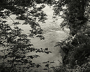 """A """"window"""" on the Potomac River, through the trees, at Riverbend Park, Virginia"""