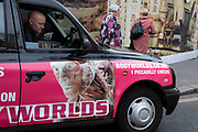 Black cab driver with his Body Worlds taxi in London, United Kingdom.