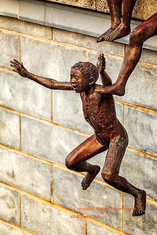 Jump!: A clever bronze sculpture depicts a young naked boy jumping into the Singapore River, Singapore.