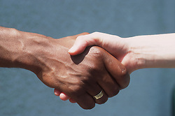 Close up of man and woman shaking hands,