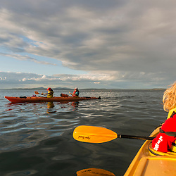 Family sea kayaking in Frenchman Bay, Acadia National Park, Maine. Porcupine Islands.