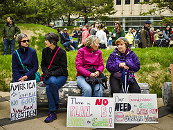 April 29, 2017 - Minneapolis, Minnesota, U.S - Women sit in front of the federal courthouse in Minneapolis before the People's Climate Solidarity March. Thousands of people marched through downtown Minneapolis and rallied around the US Federal Courthouse to participate in the People's Climate Solidarity March. The Minneapolis march coincided with other marches to protest the climate change policies of President Trump and the Republican Party that were held across the US. It took place just one week after a series of large marches in support science and fact based decision making. (Credit Image: © Jack Kurtz via ZUMA Wire)