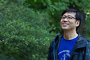 Portrait of Dr Qing Li  MD PhD, Associate Professor at Nippon Medical School. in Nezu Shrine, Tokyo, Japan. Friday October 27th 2017. Dr Li is a famous advocate and author on the subject of Forest medicine Reasearch and shinrin yoku (Forest bathing) which encourages people to spend time in forests to reap health benefits.he is also Vice president and Secretary general of the International Society of Nature and Forest Medicine.