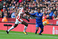 Kurt Zouma of Stoke City (l) and Demarai Gray of Leicester City battle for the ball. Premier league match, Stoke City v Leicester City at the Bet365 Stadium in Stoke on Trent, Staffs on Saturday 4th November 2017.<br /> pic by Chris Stading, Andrew Orchard sports photography.